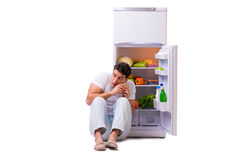 The man next to fridge full of food Royalty Free Stock Photos