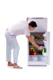 The man next to fridge full of food. Man next to fridge full of food Stock Images