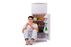The man next to fridge full of food Royalty Free Stock Image
