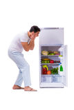 The man next to fridge full of food Stock Photo