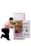 The man next to fridge full of food. Man next to fridge full of food Stock Photo