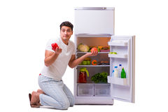 The man next to fridge full of food Stock Images