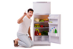 The man next to fridge full of food Stock Image