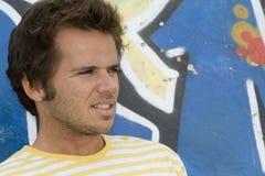 Man next to a graffiti wall stock photos