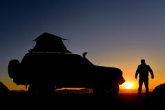 Man next to jeep watching sunset Royalty Free Stock Photography