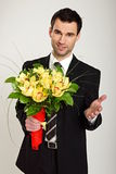 Man with nice bouquet of Orchids Royalty Free Stock Photography