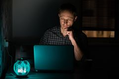 The man at night with a laptop stock images