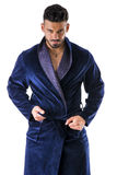 Man in night-robe undressing Royalty Free Stock Image