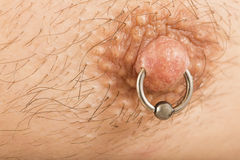 Man with nipple piercing Royalty Free Stock Photo