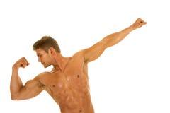 Man no shirt flex arm out Stock Image