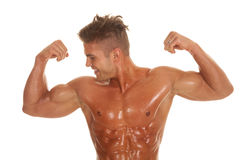 Man no shirt flexing look side very strong royalty free stock image