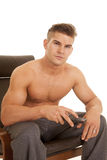 Man no shirt remote control sit point looking Royalty Free Stock Images