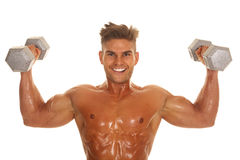 Man no shirt shiny flex both weight up Stock Photo
