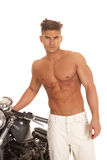 Man no shirt stand by motorcycle very serious Royalty Free Stock Images