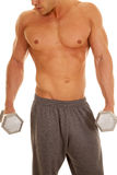 Man no shirt weights close showing chin and nose. A man with no shirt on holding on to weights looking down Royalty Free Stock Photo