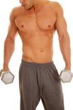 Man no shirt weights close showing chin and nose Royalty Free Stock Photo