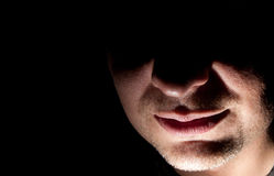 Man: Nose and Mouth. Nose and mouth of a man against a black background Stock Image