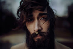 Man Nose Piercing Against Green Leaf Plants and Trees Royalty Free Stock Images