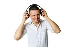 A man not enjoying what he is hearing Stock Photo