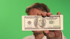 A man is not in focus, shows money. stock video footage