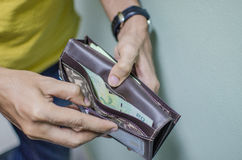 A man not have enough money in his wallet. A man not have enough thai money in his wallet royalty free stock image
