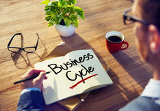 Man with a Note and Business Cycle Concepts Royalty Free Stock Images
