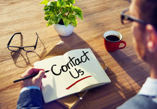 Man with a Note and Contact Us Concept Stock Image