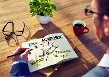 Man with a Note Pad and Agreement Concepts.  Stock Photography