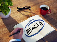 Man with Note Pad and Health Concept Stock Image