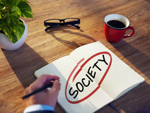Man with a Note Pad and Society Concepts Stock Photo