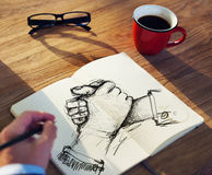 Man with a Note Pad and Togetherness Concepts.  Royalty Free Stock Image