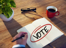 Man with Note Pad and Vote Concept Royalty Free Stock Image
