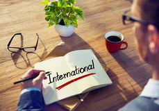 Man with a Note and a Single Word International stock image