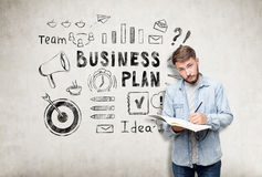Man with a notebook and business plan icons Royalty Free Stock Image