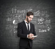 Man with notebook and business plan sketch Royalty Free Stock Image