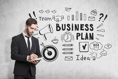 Man with notebook and business plan sketch Royalty Free Stock Images