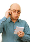 Man with notebook and phone. Royalty Free Stock Photo