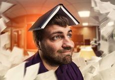 Man with notebook on his head Royalty Free Stock Photo