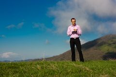 Man with notepad on mountain Stock Photo