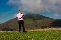 Man with notepad on mountain Stock Image
