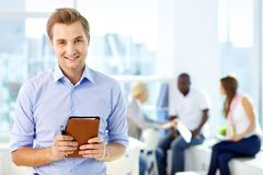 Man with notepad Stock Images