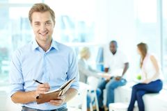 Man with notepad Stock Photography