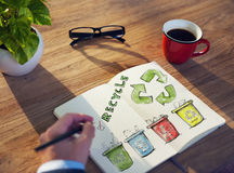 Man with a Notepad with Recycling Concept Stock Images