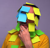 Man with notes. Man with post-it stamps Stock Photography