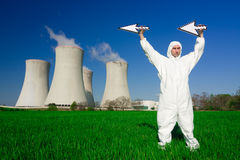 Man at nuclear power plant. Man in jumpsuit holding arrows at a nuclear power plant royalty free stock photography