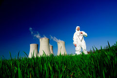 Man at nuclear power plant Stock Image