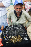 Man numismatist shows his collection of coin. Tyumen, Russia - June 24, 2016: The 5th open championship of Russia on a plowed land. Man numismatist shows his Royalty Free Stock Photos