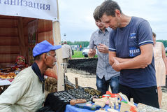 Man numismatist shows his collection of coin. Tyumen, Russia - June 24, 2016: The 5th open championship of Russia on a plowed land. Man numismatist shows his Royalty Free Stock Image