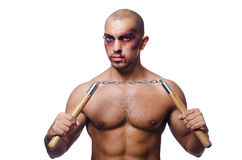 Man with nunchucks Royalty Free Stock Photo