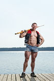 Man with oar Stock Photo